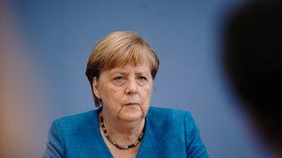 La chancelière allemande Angela Merkel lors d'une conférence de presse à Berlin, le 28 août 2020. (MICHAEL KAPPELER / DPA-POOL/AFP)