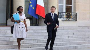 Sibeth Ndiaye aux côtés d'Emmanuel Macron à l'Elysée, le 17 octobre 2017. (LUDOVIC MARIN / AFP)