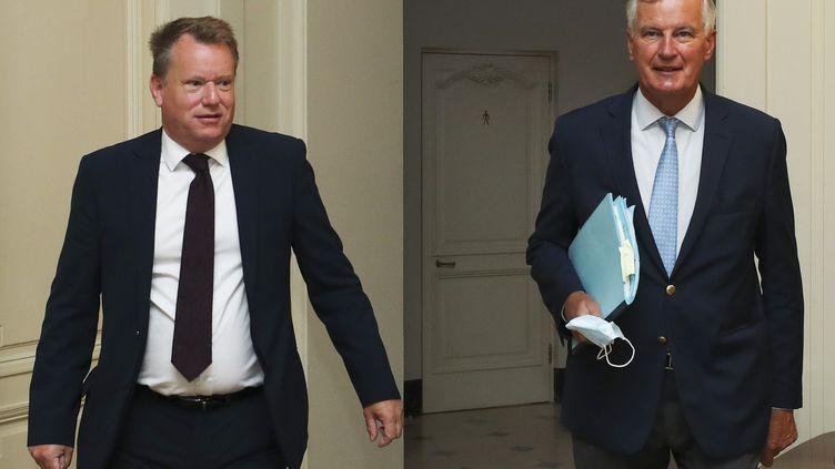 Le négociateur en chef britannique, David Frost (à gauche), et son homologue européen, Michel Barnier, à Bruxelles, le 21 août 2020. (YVES HERMAN / POOL / AFP)