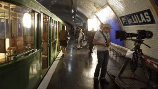 """FRANCE, Paris : People visit an unused area of the metro station """"Porte des Lilas"""", where an old Paris' metro wagon is displayed, on September 17, 2011 in Paris. This area, used for movies, opened its doors today as part of the European heritage open days. For two days a year in Paris and the rest of France, thousands of monuments, government buildings, and privately owned sites of interest open their doors to give the public free reign to areas that are generally not accessible. AFP PHOTO THOMAS SAMSON  (AFP PHOTO THOMAS SAMSON)"""