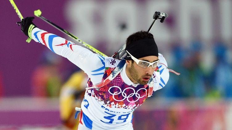 Le biathlète Martin Fourcade, le 8 février 2014, lors de l'épreuve de sprint des JO de Sotchi, en Russie. (PHILIPPE MILLEREAU / AFP)