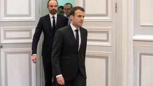 Emmanuel Macron et Edouard Philippe à Paris le 23 mars. (PHILIPPE WOJAZER / POOL)