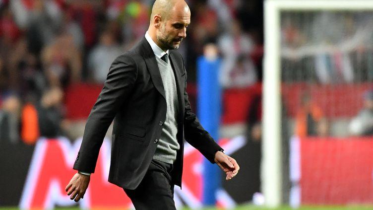 L'entraîneur de Manchester City, Pep Guardiola (PASCAL GUYOT / AFP)