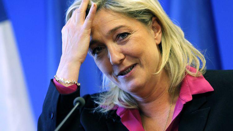 La candidate du FN à la présidentielle, Marine Le Pen, tient une conférence de presse au siège de son parti, le 12 décembre 2011 à Nanterre (Hauts-de-Seine). (SOLAL / SIPA)