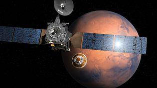Une vue d'artiste de la mission ExoMars 2016 à l'approche de la planète rouge. (D. DUCROS / EUROPEAN SPACE AGENCY / AFP)