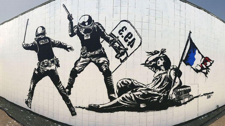 """(""""L'Etat matraquant la liberté""""- Grenoble France 2016 © Capture écran www.goinart.net)"""