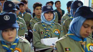 Réunion de scouts à Kaboul qui apprennent à repérerles multiples formes de mines sur le terrain quituent des dizaines de personnes chaque mois, dont de nombreux enfants. (SHAH MARAI / AFP)