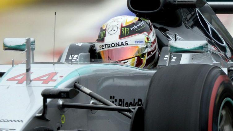 Le Britannique Lewis Hamilton au volant de sa Mercedes (ALEXANDER NEMENOV / AFP)