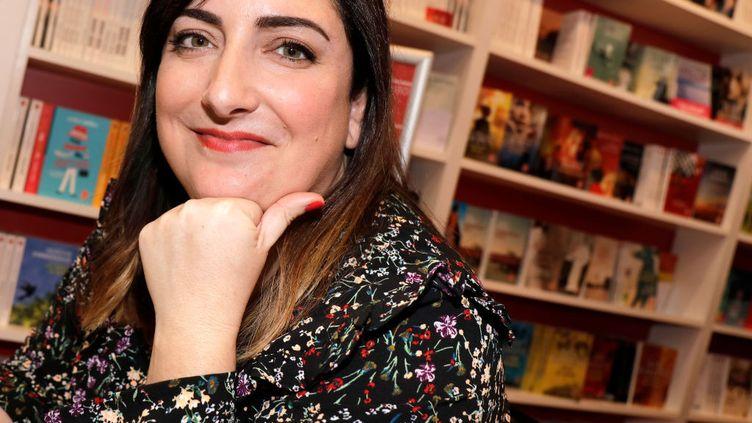 Virginie Grimaldi, romancière au succès fulgurant, lors du salon Livre Paris, en 2018  (ERIC FOUGERE - CORBIS / CORBIS ENTERTAINMENT)