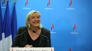 Marine Le Pen, lors d'une conférence de presse au siège du Front national à Nanterre (Hauts-de-Seine), le dimanche 23 mars 2014. (KENZO TRIBOUILLARD / AFP)