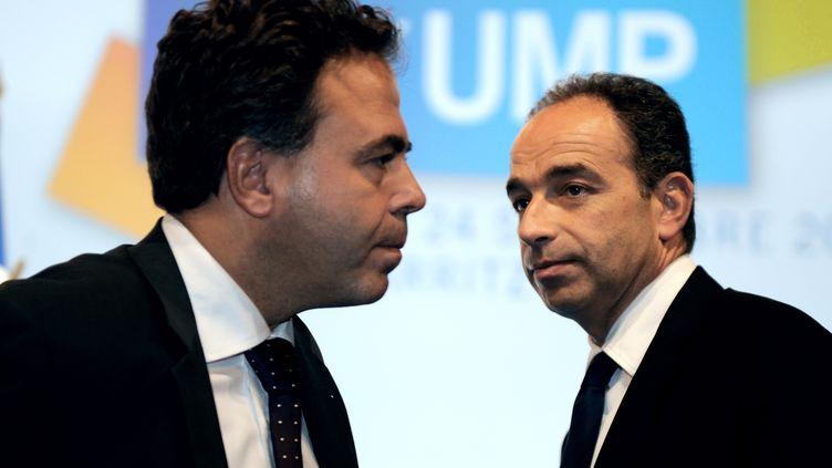 Luc Chatel et Jean-François Copé, le 24 septembre 2010 à Biarritz (Pyrénées-Atlantiques). (JEAN-PIERRE MULLER / AFP)