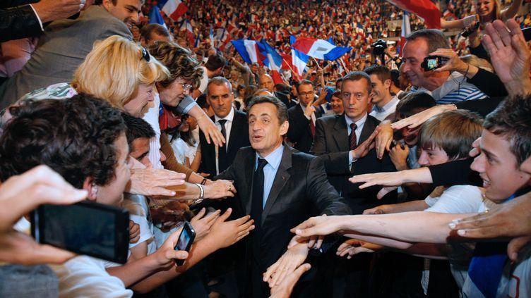 L'ancien président de la République, Nicolas Sarkozy, lors d'un meeting de campagne le 3 mai 2012 à Toulon (Var). (CLAUDE PARIS / AFP)
