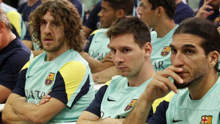 Carles Puyol, Lionel Messi et José Pinto, les joueurs du FC Barcelone
