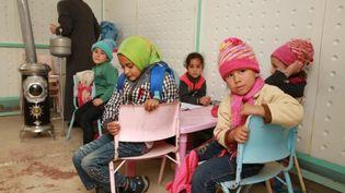 Des réfugiés syriens dans un camp à Beyrouth (Liban), le 13 mars 2014. (IHH / ANADOLU AGENCY / AFP)