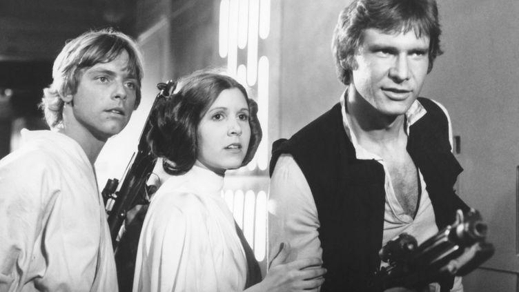 "Mark Hamill, Carrie Fisher et Harrison Ford dans ""Star Wars"", en 1977. (LUCAS FILM / WALT DISNEY / AFP)"
