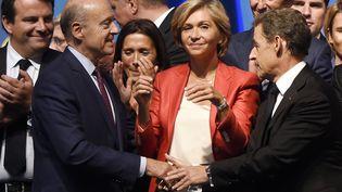 Alain Juppé et Valérie Pécresse, le 27 septembre 2015 à Nogent-sur-Marne (Val-de-Marne) (DOMINIQUE FAGET / AFP)