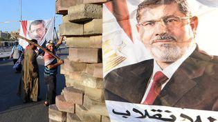 Des supporters du président islamiste déchu Mohamed Morsi dans les rues du Caire (Egypte), le 28 juillet 2013. (FAYEZ NURELDINE / AFP)