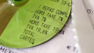 La TVA dans la restauration était passée en 2009 de 19,6% à 5,5%, puis à 7% en 2012. (DAMIEN MEYER / AFP)