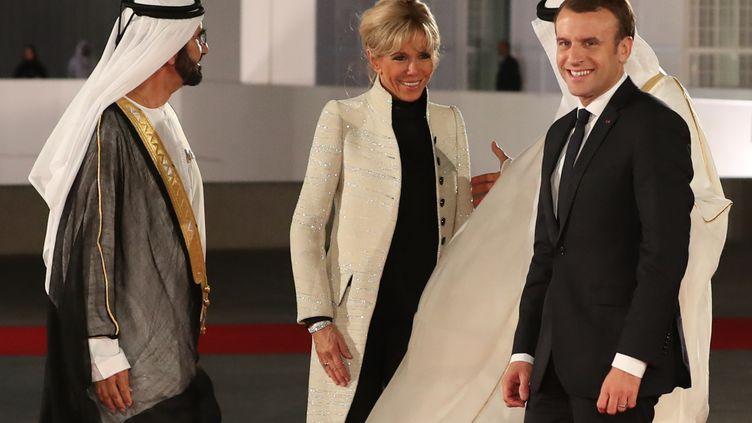 Emmanuel et Brigitte Macron à l'inauguration du Louvre Abu Dhabi, le 8 novembre 2017. (KARIM SAHIB / AFP)