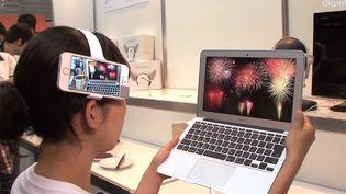 Capture d'une vidéo de Diginfo news diffusée sur Youtube montrant le dispositif neurocam, présenté au Japon, en octobre 2013. (YOUTUBE / FRANCETV INFO)