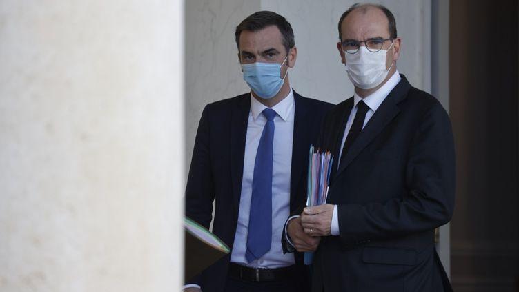 Le ministre de la Santé Olivier Véran et le Premier ministre Jean Castex à l'Elysée, le 14 octobre 2020. (LUDOVIC MARIN / AFP)