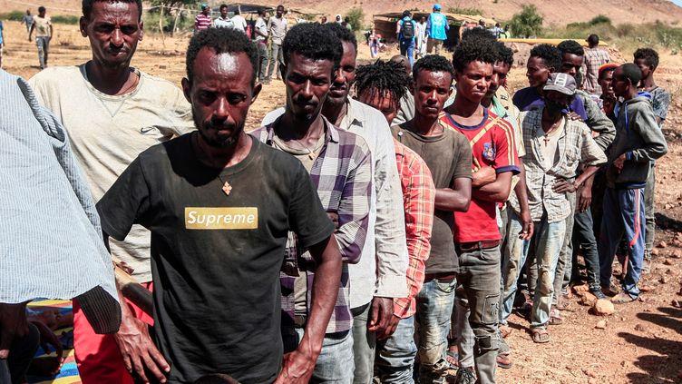 Réfugiés éthiopiens à leur arrivée au camp d'Oum Raquba, dans la province soudanaise de Gedaref, le 16 novembre 2020. Ils ont fui les combats et les bombardements dans la province éthiopienne du Tigré.  (Ebrahim HAMID / AFP)