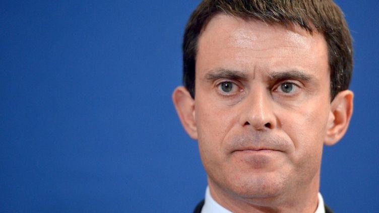 Le ministre de l'Intérieur, Manuel Valls, à Evry(Essonne), le 27 mars 2013. (MIGUEL MEDINA / AFP)