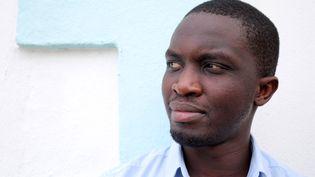 Portrait de l'écrivain sénégalais Mohamed Mbougar Sarr, 30 novembre 2015 (RICHARD BOUHET / AFP)