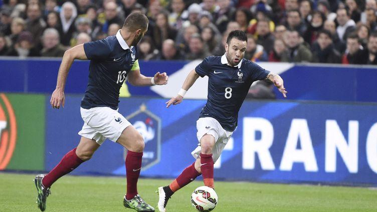 Mathieu Valbuena et Karim Benzemalors de France-Brésil, le 26 mars 2015, au Stade de France. (JEAN-MARIE HERVIO / DPPI MEDIA / AFP)