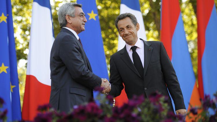 Nicolas Sarkozy avec le président arménien Serge Sarkissian, le 7 octobre 2011 à Erevan. (ERIC FEFERBERG / AFP)