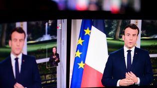 Le président de la République, Emmanuel Macron lors de ses voeux depuis l'Elysée, le 31 décembre 2019. (MARTIN BUREAU / AFP)