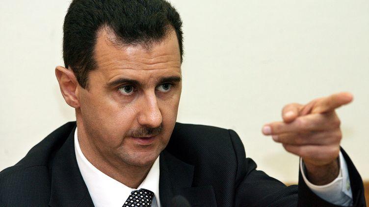 Le président syrien Bachar Al-Assad, pendant une conférence de presse en décembre 2006. (YURI KADOBNOV/AFP)