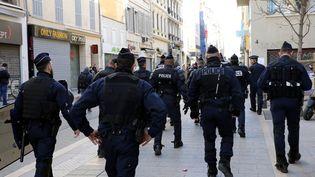"""Des policiers à Marseille, le 3 mars 2019, lors du seizième samedi de manifestation des """"gilets jaunes"""". (MAXPPP)"""
