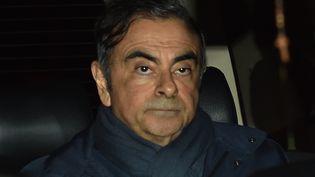 Carlos Ghosn, après avoir quitté le bureau de son avocat, le 3 avril. (KAZUHIRO NOGI / AFP)