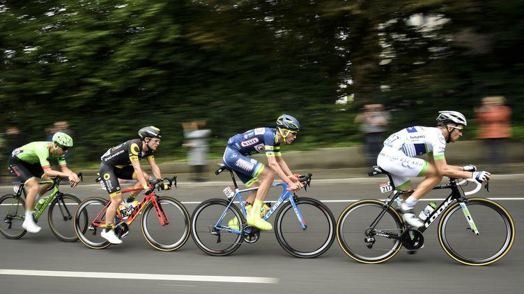 Les quatre échappéslors de la deuxième étape du Tour de France, entreDüsseldorf (Allemagne) et Liège (Belgique). (LIONEL BONAVENTURE / AFP)