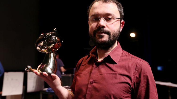 """Le dessinateur Riad Sattouf, dont """"L'Arabe du Futur"""" a été sacré Fauve d'or au festival d'Angoulême, le 1er février 2015. (JEAN-BAPTISTE QUENTIN / MAXPPP)"""