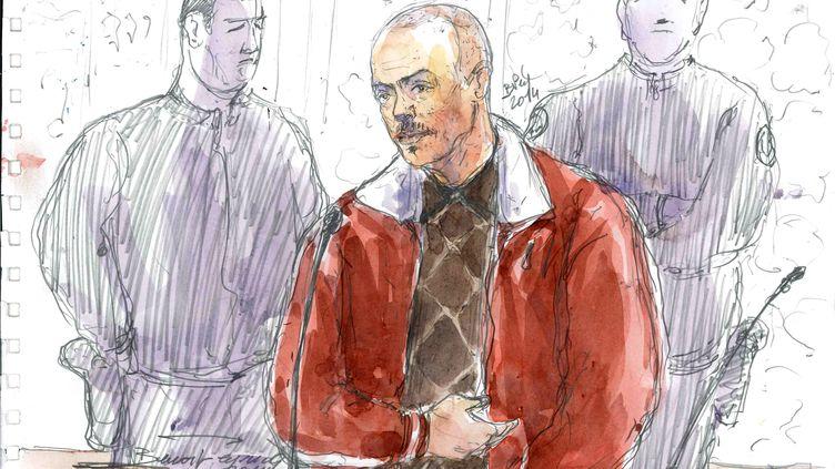 Tony Meilhon le 18 novembre 2014 dans le boxe des accusés lors de son procès à Rennes (Ille-et-Vilaine). (BENOIT PEYRUCQ / AFP)