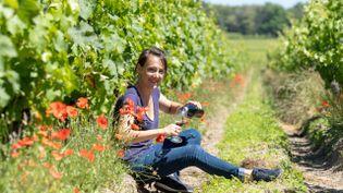 """L'oenologue Audrey Wambre a créé l'atelier """"Ecoute et goûte"""" qui propose une séance de yoga avant une dégustation de vin. (GAELLE BC)"""