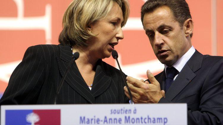 Marie-Anne Montchamp et Nicolas Sarkozy, le 23 septembre 2005. (MAXPPP)