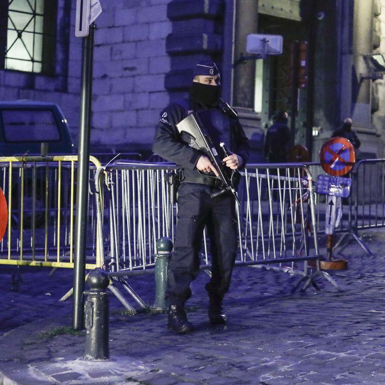 Photo d'illustration montrant des policiers devant le palais de Justice de Bruxelles, le15 mars 2018. (THIERRY ROGE / AFP)