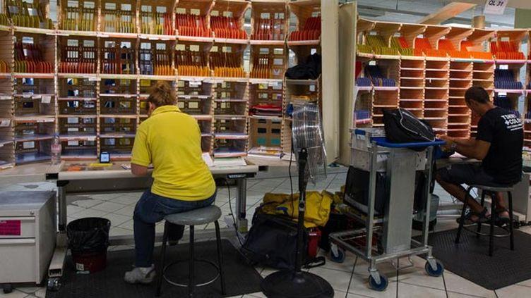 (La Cour des comptes estime que le travail des postiers n'a pas assez évolué © ROMUALD MEIGNEUX/SIPA)