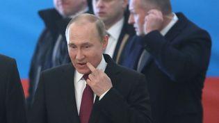 Le candidat et président Vladimir Poutine,dans un bureau de vote lors de l'élection présidentielle russe à Moscou, le 18 mars 2018. (SERGEI CHIRIKOV / POOL)