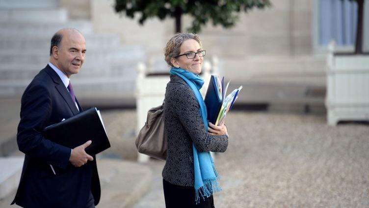 Le ministre de l'Economie, Pierre Moscovici, et l'ancienne ministre de l'Ecologie, Delphine Batho, le 31 octobre 2012 à l'Elysée. (MARTIN BUREAU / AFP)