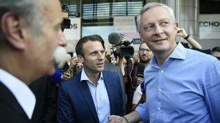 Emmanuel Macron et Bruno Le Maire, le 12 septembre 2016, à Paris. (ERIC FEFERBERG / AFP)