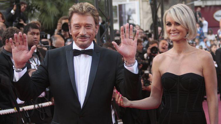 Johnny et Laeticia Hallyday le 17 mars 2009 à Cannes (Alpes-Maritimes). (FRANCOIS GUILLOT / AFP)