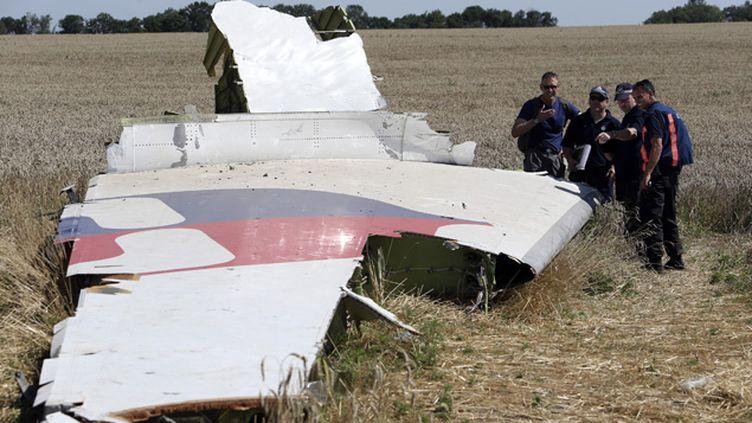 (Des experts internationaux sur le site du crash début août © REUTERS | Sergei Karpukhin)