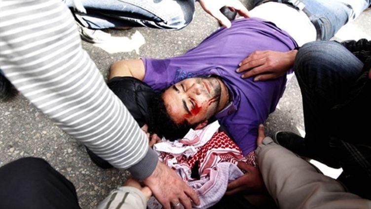 Répression à Amman (25 mars 2011) (AFP/KHALIL MAZRAAWI)
