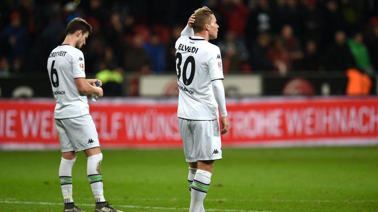 Les joueurs de Moenchengladbach (PATRIK STOLLARZ / AFP)