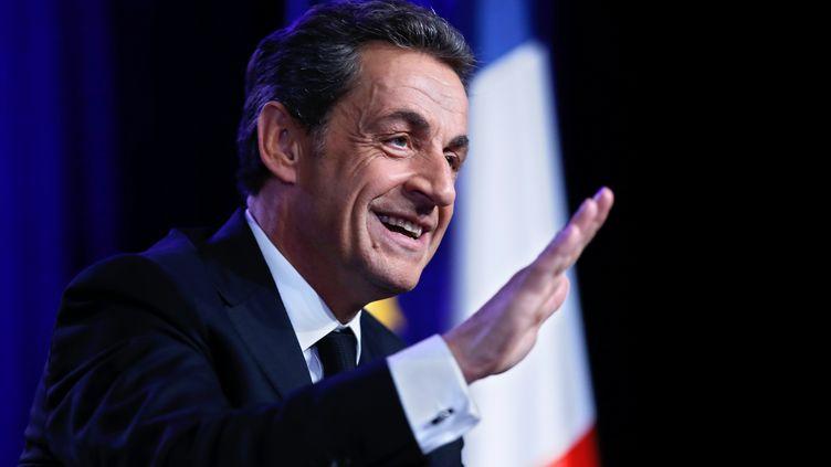 L'ancien président de la République, Nicolas Sarkozy, lors d'un meeting à Asnières-sur-Seine (Hauts-de-Seine), le 24 mars 2015. (THOMAS SAMSON / AFP)