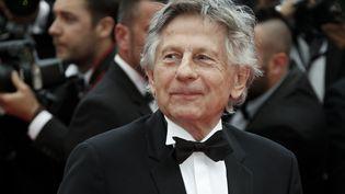 """Roman Polanski à la projection du film """"Saint-Laurent"""" au festival de Cannes (Alpes-Maritimes), le 17 mai 2014. (VALERY HACHE / AFP)"""